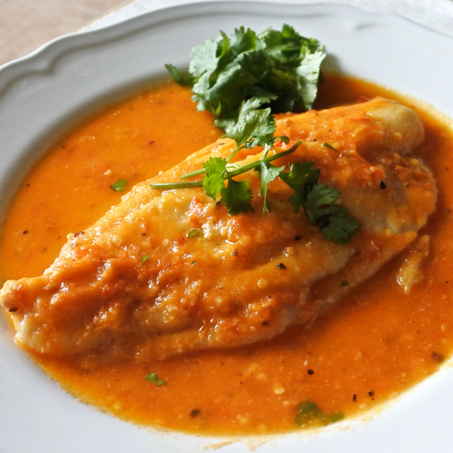 John Dory poached in a spicy tomato, chile and wine broth